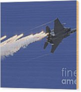 An F-15e Strike Eagle Releases Flares Wood Print