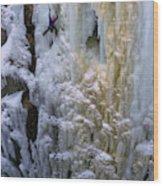 An Ice Climber Ascends A Frozen Wood Print