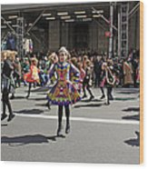 An Irish Dance Group Flying High While Dancing At The 2009 St. Patrick Day Parade Wood Print