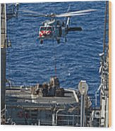An Mh-60s Sea Hawk Delivers Supplies Wood Print