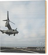 An Mv-22 Osprey Is Guided Onto Wood Print by Stocktrek Images