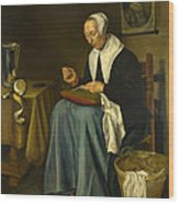 An Old Woman Seated Sewing Wood Print
