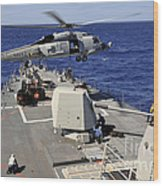 An Sh-60b Sea Hawk Helicopter Picks Wood Print