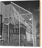 anti rpg cage surrounding observation sanger at North Queen Street PSNI police station Belfast North Wood Print by Joe Fox