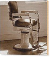 Antiquated Barber Chair In Sepia Wood Print