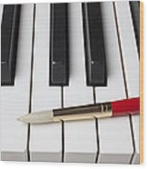 Artist Brush On Piano Keys Wood Print