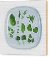 Assorted Fresh Herb Leaves On Blue Plate Wood Print
