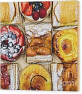 Assorted Tarts And Pastries Wood Print by Elena Elisseeva
