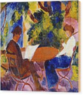 At The Garden Table Wood Print by August Macke