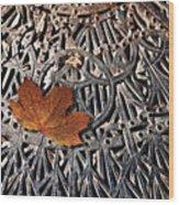 Autumn Leave On Iron Grate Wood Print