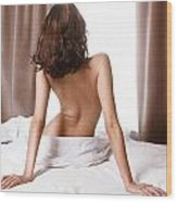 Back Of Woman Sitting Naked On Bed In Front Of Window Wood Print