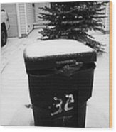 bag sticking out of litter waste bin covered in snow outside house in Saskatoon Saskatchewan Canada Wood Print