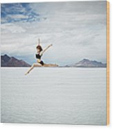 Ballerina Leaping In Mid-air Over Lake Wood Print