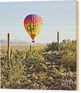Balloon Ride Over The Desert Wood Print