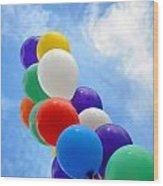 Balloons Against A Cloudy Sky Wood Print