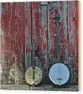 Banjos Against A Barn Door Wood Print