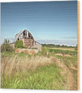 Barn In A Field With Hay Bales Wood Print