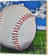 Baseball In The Grass Wood Print