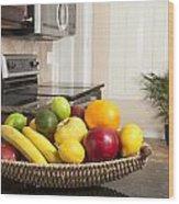 Basket Of Fresh Fruit In Modern Kitchen Wood Print