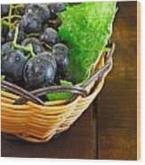 Basket Of Grapes On Rustic Wooden Table Wood Print