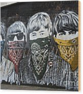 The Beatles wearing face masks street mural Wood Print