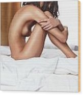 Beautiful Young Woman Sitting Naked On A Bed Wood Print