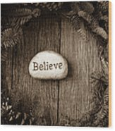 Believe In Text In The Center Of A Christmas Wreath Wood Print
