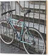 Bicycle Is Chained To A Fence Wood Print