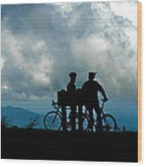 Bicyclists In The Clouds Wood Print