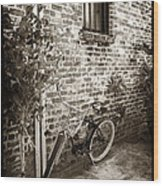 Bike In Pirates Alley Wood Print by John Rizzuto