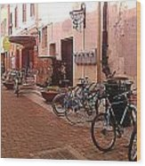Bikes In Alley Wood Print by Emily Clingman