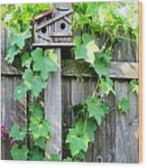 Birdhouse Sitting On A Fence Wood Print