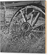 Black And White Photo Of An Old Broken Wheel Of A Farm Wagon Wood Print