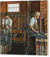 Blacksmith And Apprentice Wood Print