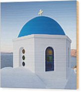 Blue Domed Church In Oia Santorini Greece Wood Print by Matteo Colombo