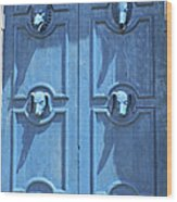 Blue Door Decorated With Wooden Animal Heads Wood Print