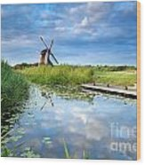 Blue Sky And Windmill Reflected In River Wood Print