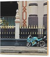 Blue Yellow Sporty Motorcycle Parked On Pavement Wood Print