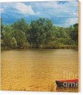 Boat On A Golden Pond Wood Print