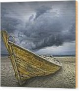 Boat On The Beach With Oncoming Storm Wood Print