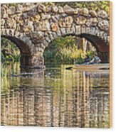 Boaters Under The Bridge Wood Print