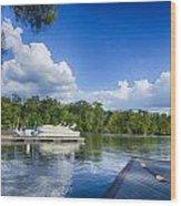Boats At Dock On A Lake With Blue Sky Wood Print