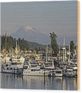 Boats Docked At A Harbor With Mountain Wood Print