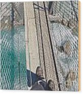 Boots On Swing Bridge Over Troubled White Water Wood Print