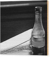 Bottle Near Window Wood Print