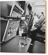 Bottle Of Water On Tray Table Interior Of Jet2 Aircraft Passenger Cabin In Flight Europe Wood Print by Joe Fox