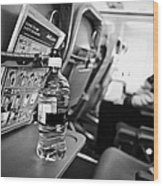 Bottle Of Water On Tray Table Interior Of Jet2 Aircraft Passenger Cabin In Flight Wood Print by Joe Fox