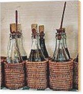Bottles In Baskets Wood Print