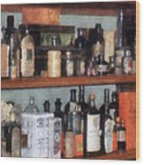 Bottles In General Store Wood Print
