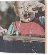 Boy Mesmerised By The Element Of Water In Motion Wood Print